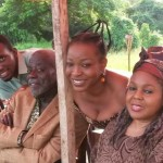 Former Ghana Actors Guild President, Fred Amugi with other actresses