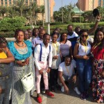 Some winners pose for a picture in front of palm jumeirah hotel in Dubai