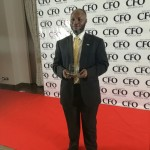 Modupke Kadiri, MTN CFO displaying the award