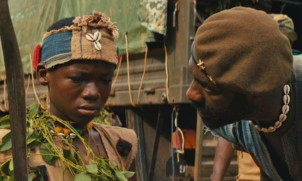 """Abraham Attah and Idris Elba in """"Beasts of no Nations"""""""
