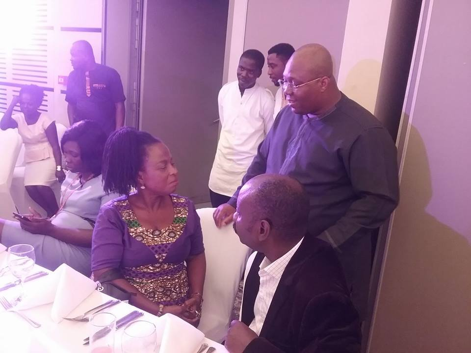 Dr. Dzani (standing) in a chat with MP for Ada, Hon. Doeyo Ghansah and Dr. Narh at the 2017 Asafotufiam launch